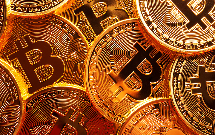 Gold coins with Bitcoin logo