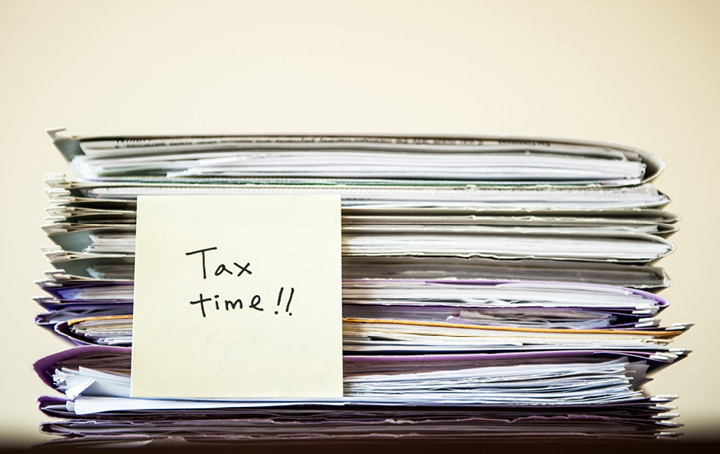 Stack of tax returns at Tax Time