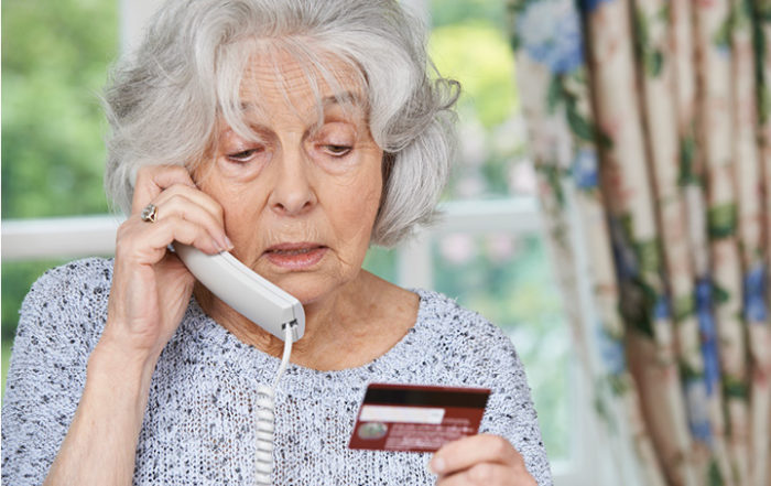 women on phone with creditcard