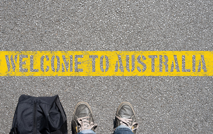 Welcome To Australia on road in yellow paint