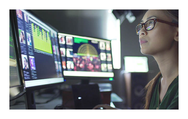 Women looking at screens